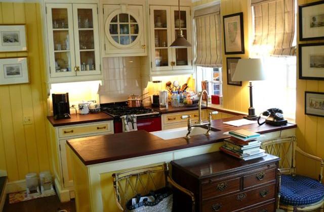 sunflower yellow and white kitchen with an Aga range - Fairfax & Sammons via Atticmag