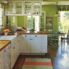 kiwi green kitchen - Caroline Rhea's kiwi color kitchen with white cabinets by Amanda Nisbet - Home Mag via Atticmag