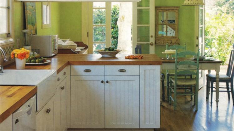kiwi green kitchen - Caroline Rhea's kiwi color kitchen with white cabinets by Amanda Nisbet - Home Mag via Atticmag