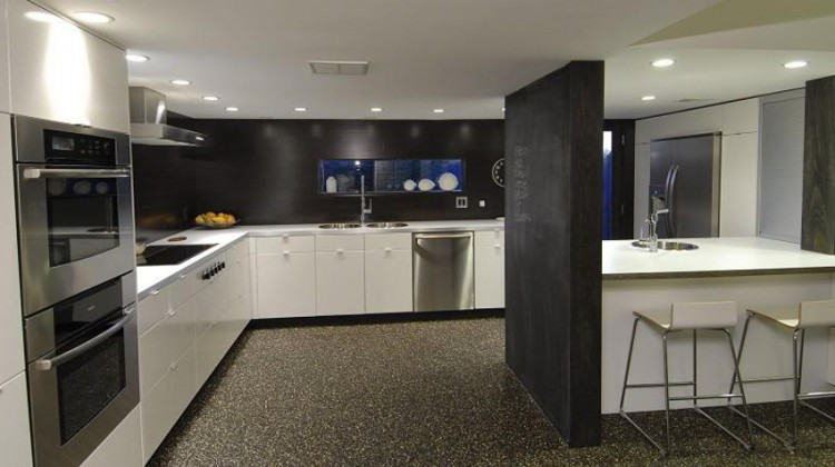 modern black and white kitchen - mid century modern kitchen with white cabinets and black accents - supafly.com via atticmag