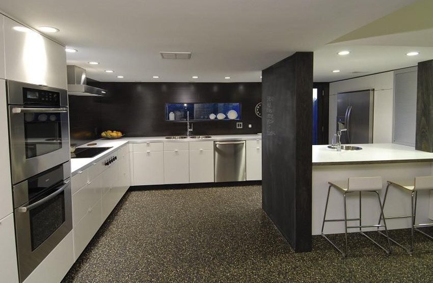 In A Modern Black And White Kitchen The Lack Of Color Emphasizes Shapes Surface Textures