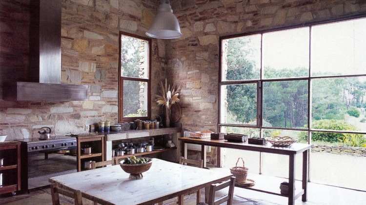 modern kitchen with stone walls in Argentina - WOI via Atticmag