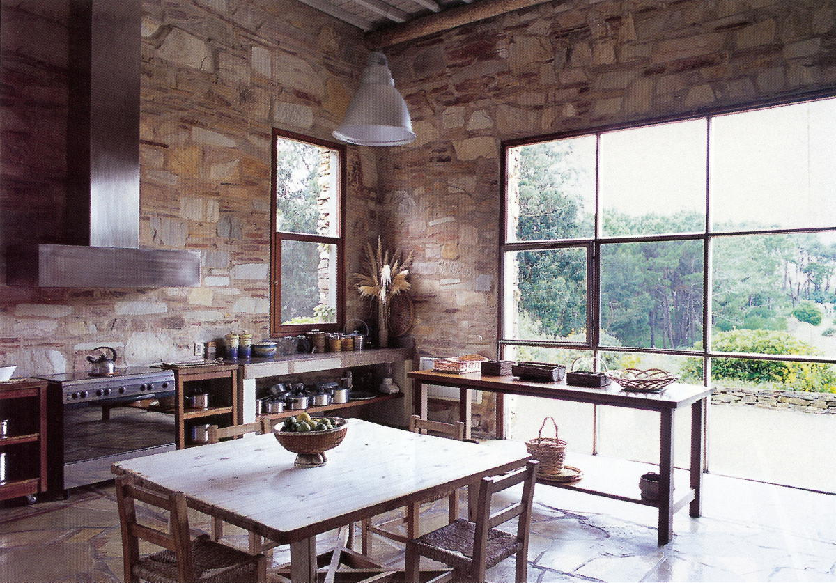 natural materials - modern kitchen with stone walls in Argentina - WOI via Atticmag