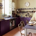 purple cabinet kitchen - Parisian loft kitchen with purple cabinets and cream walls - Marie Claire Maison via Atticmag