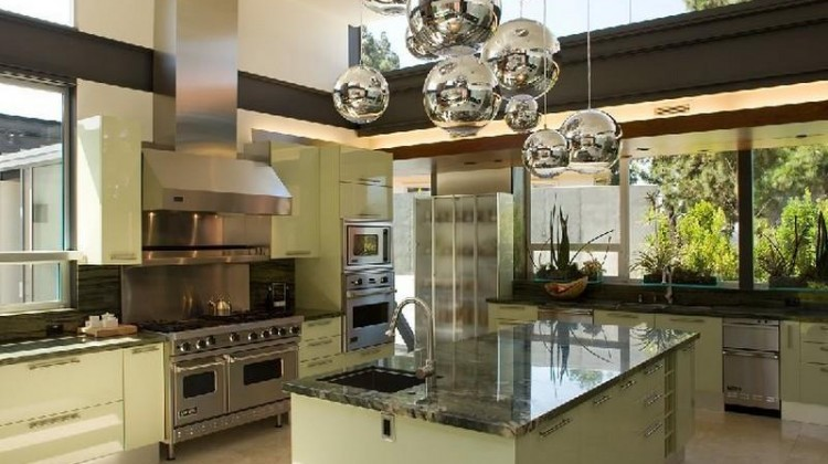 house with mid century style modern kitchen with bubble chandelier and window walls - Luxist via Atticmag