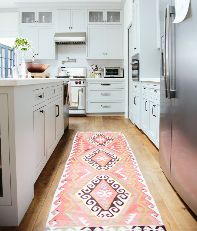 kitchen rugs - vintage kilim runner in a white kitchen - via Atticmag