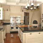 wood burning oven kitchen - black and white kitchen with beehive pizza oven - Scott Yetman via Aticmag