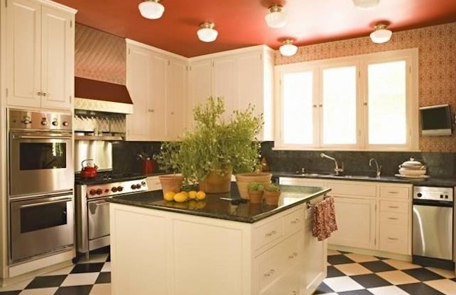 red kitchen accents - black and white kitchen with red ceiling by Joe Nye via Atticmag