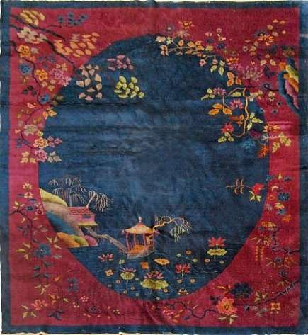rug artistry - Nichols chinese art deco carpet with blue oval ground and burgundy border with floral motifs - 1st Dibs via Atticmag