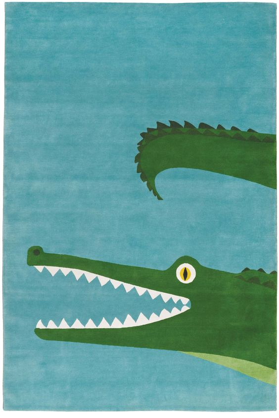 kids room rug - Croco Tibetan rug with a turquoise ground and green crocodile - The Rug Company via Atticmag