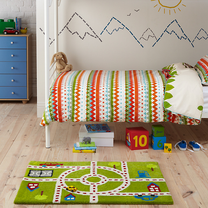 kids room rug - Small Road rug with green background has a play theme - John Lewis via Atticmag