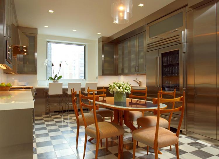 modern stainless kitchen with checkerboard floor - Nathan Egan via Atticmag