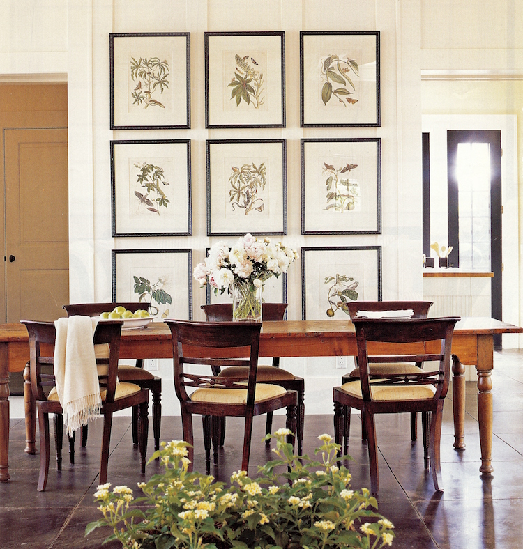 picture wall ideas - 3 rows of 3 botanical prints as the backdrop for a dining room wall - Country Home via Atticmag