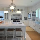 renovated white kitchen at Fenwick, the home of actress Katharine Hepburn - Town & Country via Atticmag