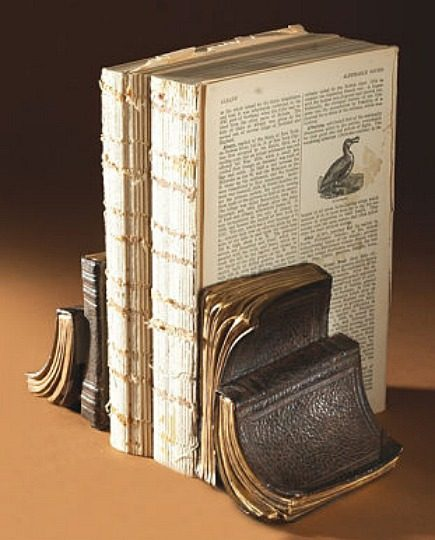 bookends - faux antique leather bound book bookends from Wrapables -via atticmag
