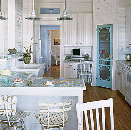 kitchen feature ideas - Victorian screen door used on a cottage-style pantry - via atticmag