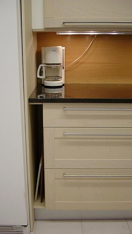 kitchen feature ideas - veritcal open storage area in base cabinets - Leena Singh via Atticmag