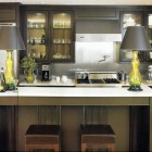 modern drab green kitchen with undertones of brown and gray - Home Mag via Atticmag