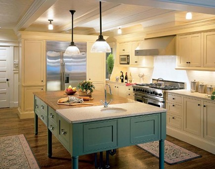 white kitchen with seafoam blue island - Hutker Architects via Atticmag
