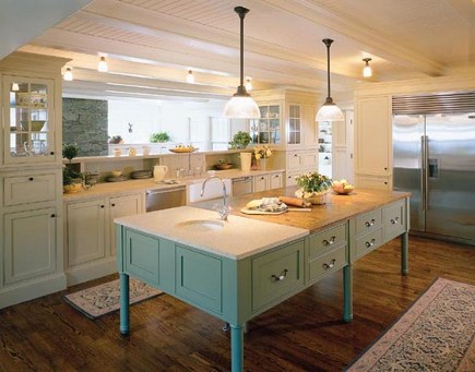 white kitchen with seafoam blue island - Hutker Architects via Atticmag