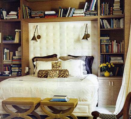 wall lights- bed with swing arm sconces mounted on the headboard - Domino via Atticmag