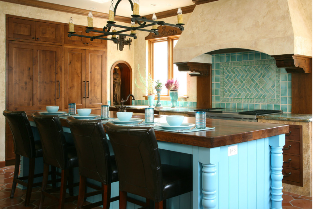 overview of turquoise tile mexican style kitchen - Jean Stoffer Design via Atticmag