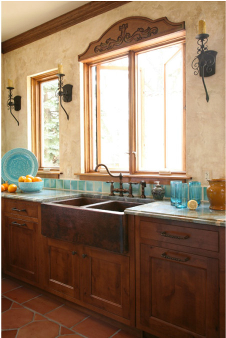 sink area in turquoise tile mexican style kitchen - Jean Stoffer Design via Atticmag