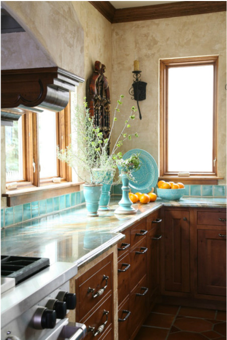 detail of range wall in turquoise tile mexican style kitchen - Jean Stoffer Design via Atticmag