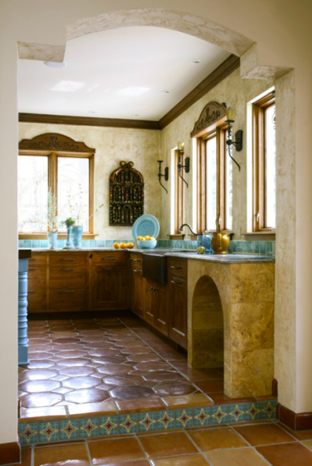 detail of saltillo tile floor and lower cabinets in turquoise tile mexican style kitchen - Jean Stoffer Design via Atticmag
