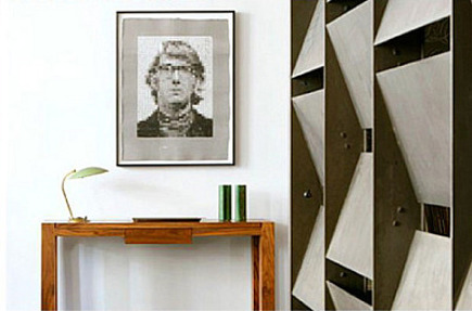 loft entry - entry with sculptured metal wall by S. Russell Groves- via Atticmag