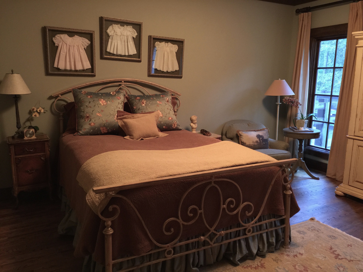 alabama stone cottage - iron bed with peacock alley bedding in guest bedroom - atticmag