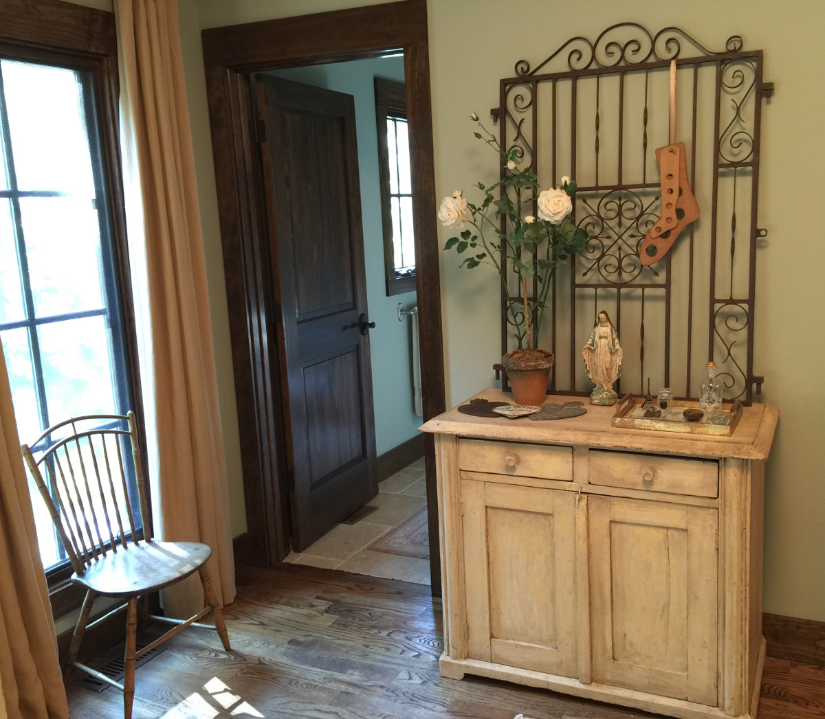alabama stone cottage - iron gate used indoors on painted chest in guest bedroom - atticmag