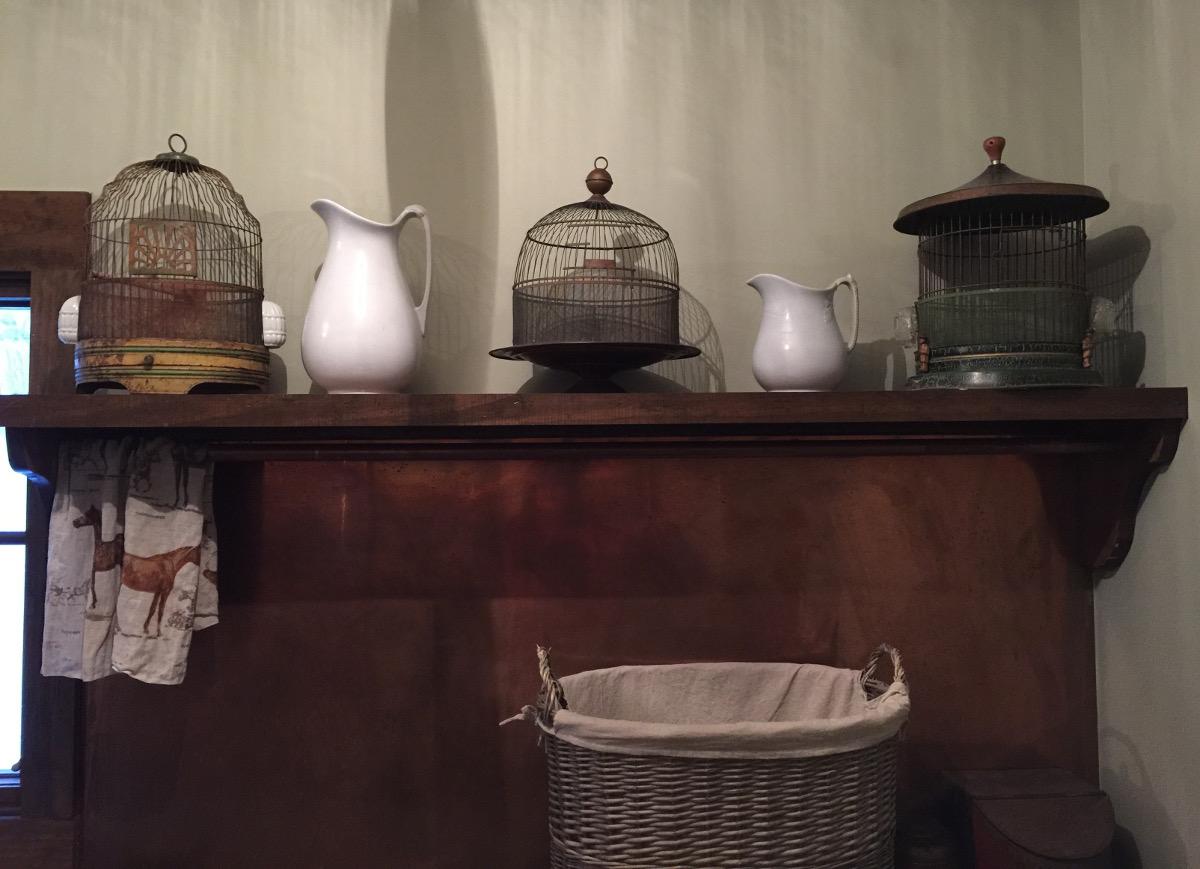 stone cottage details - collection of antique birdcages on shelf - Atticnag