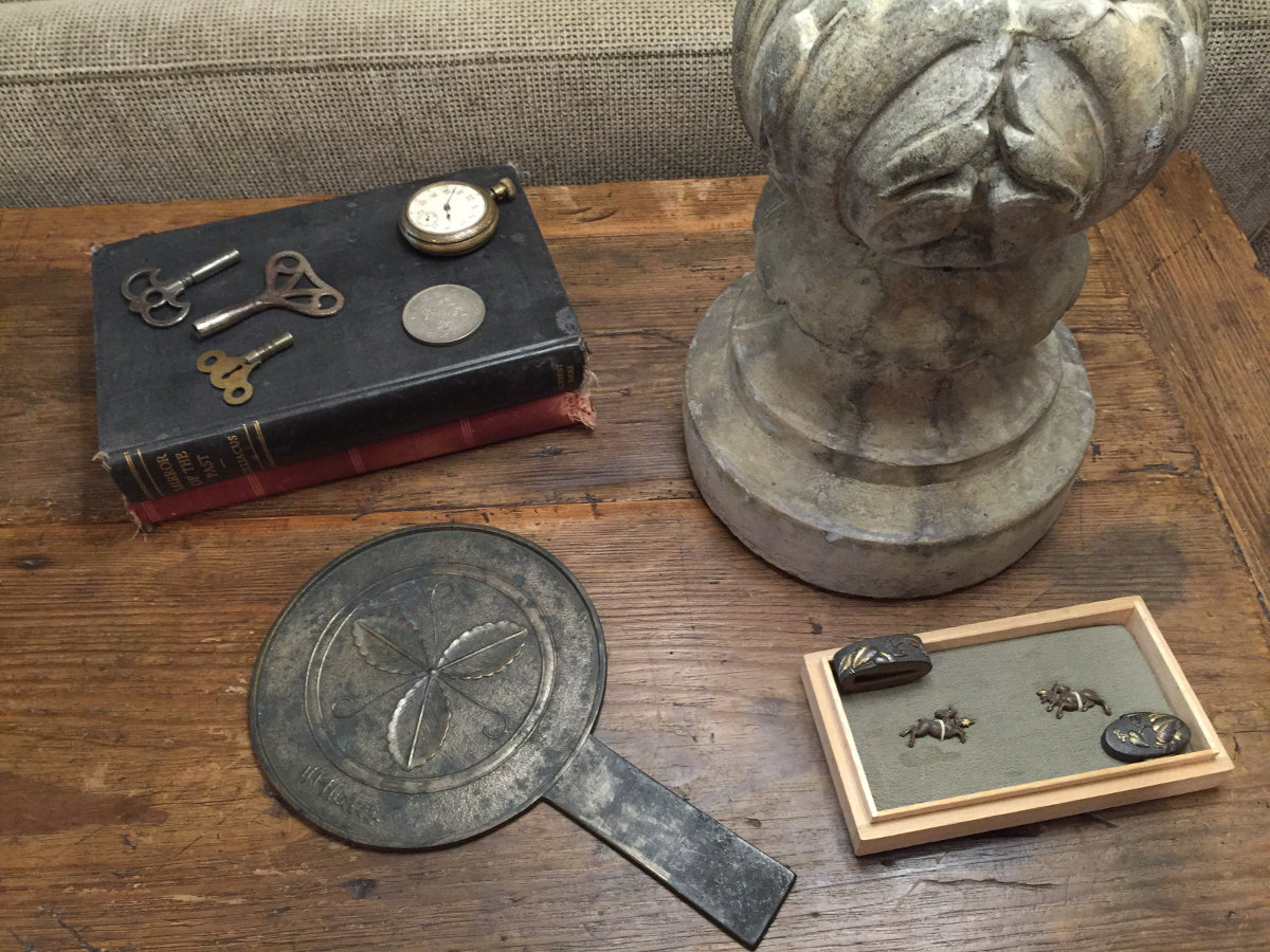 stone cottage details - Japanese metal mirror and bronze sword pieces - Atticmag