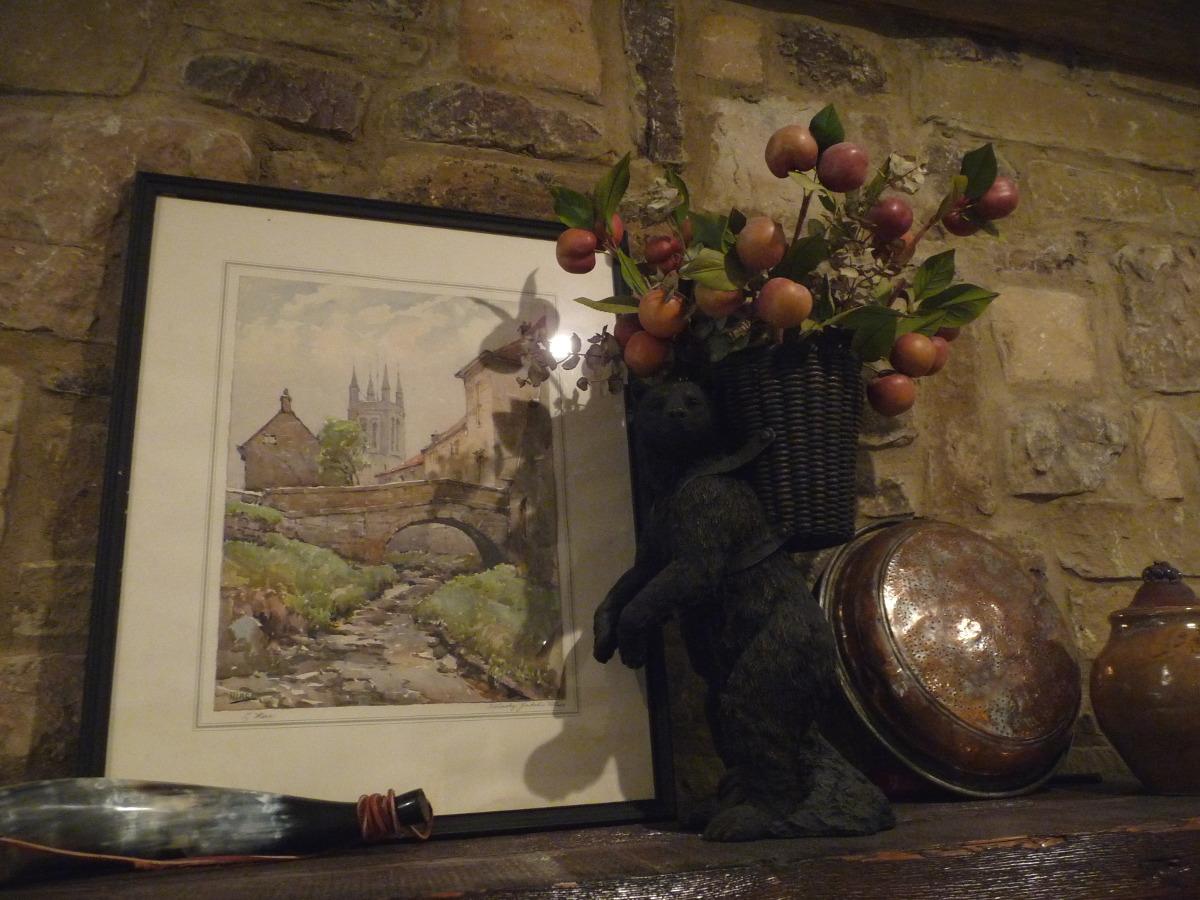 stone cottage details - fireplace cedar beam mantel vintage accessories - Atticmag
