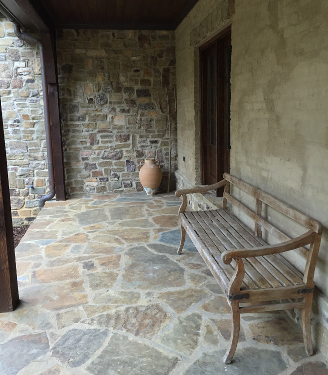 stone cottage details - wooden bench on the front veranda - atticmag
