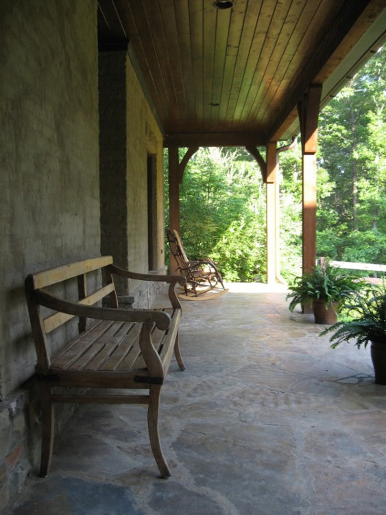 alabama stone cottage - front veranda with stone floor - atticmag