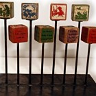 vintage collections - vintage childrens' blocks mounted for display - Lost Found Art and Curiosity Gallery via Atticmag