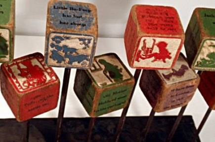 vintage collections - close up of mounted vintage childrens blocks -Lost Found Art and Curiosite Gallery via Atticmag
