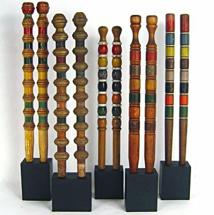 vintage collections - pairs of croquet posts mounted like sculptures -- Lost Found Art and Curiosite Gallery via Atticmag