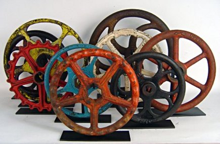 vintage collections - colorful valve wheels mounted like sculptures - Scott Sanders via Atticmag