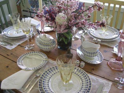 heirloom tablescape - table set with vintage Swedish china and American depression glass - Atticmag