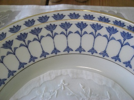 heirloom tablescape - antique Rorstrand blue and white gold-rim china with a Venetian voile doily- Atticmag