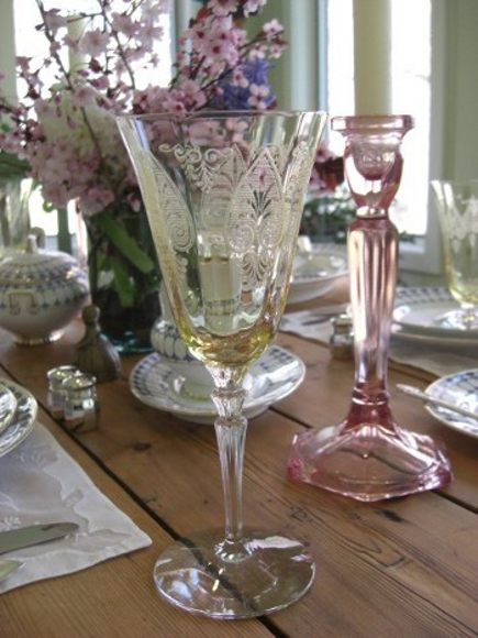 heirloom tablescape - Fostoria Trojan bronze Depression glass goblet and a pink pressed glass early 20th century candlestick - Atticmag