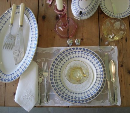 heirloom tablescape - place setting of Swedish Rorstrand china, American depression glass and English silver fish knives and forks - Atticmag