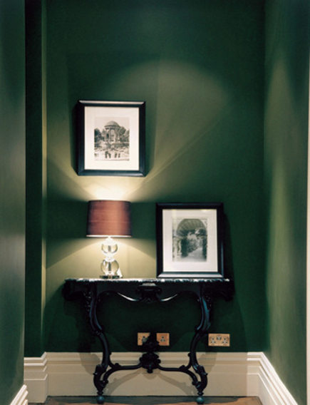 dark rooms -British racing green walls in an entry hall - via Atticmag