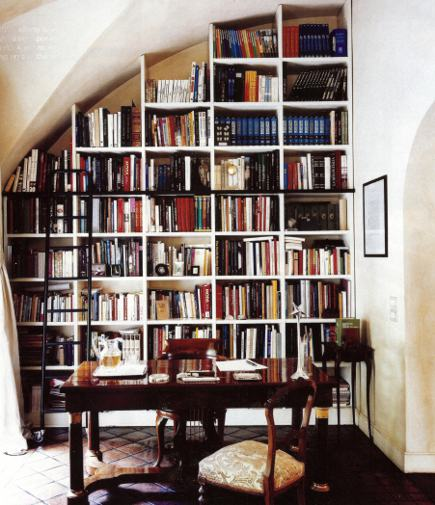 rolling library ladder in a hallway at Alberta Feretti's house - Town & Country via Atticmag