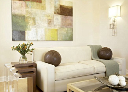 pastel color block painting over a white sofa on a living room wall -Lori Dennis via Atticmag
