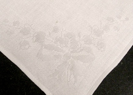 floral linens - white damask napkin with lily of the valley motif on the corner - Atticmag
