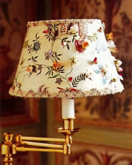 extreme decorating - swing-arm sconce with custom, embroidered shade - NY Mag via Atticmag